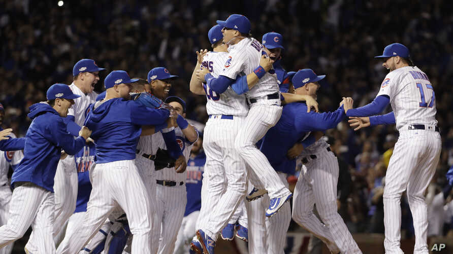 Chicago Cubs players celebrate after Game 6 of the National League baseball championship series against the Los Angeles Dodgers, Saturday, Oct. 22, 2016, in Chicago. The Cubs won 5-0 to win the series and advance to the World Series against the Cleve