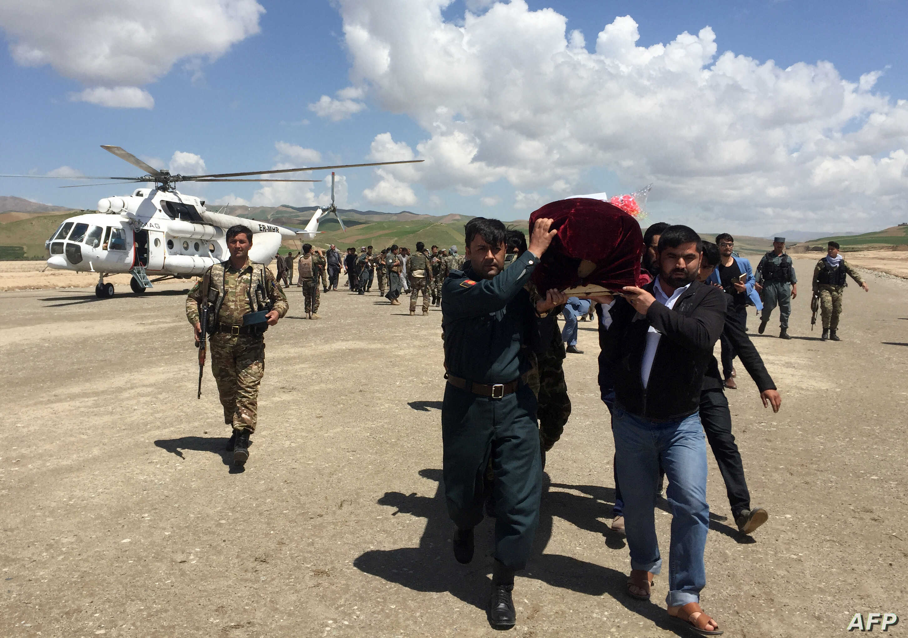 FILE - Relatives carry the coffin of an Afghan National Army soldier killed in a Taliban attack in Takhar province, Afghanistan, April 23, 2017.