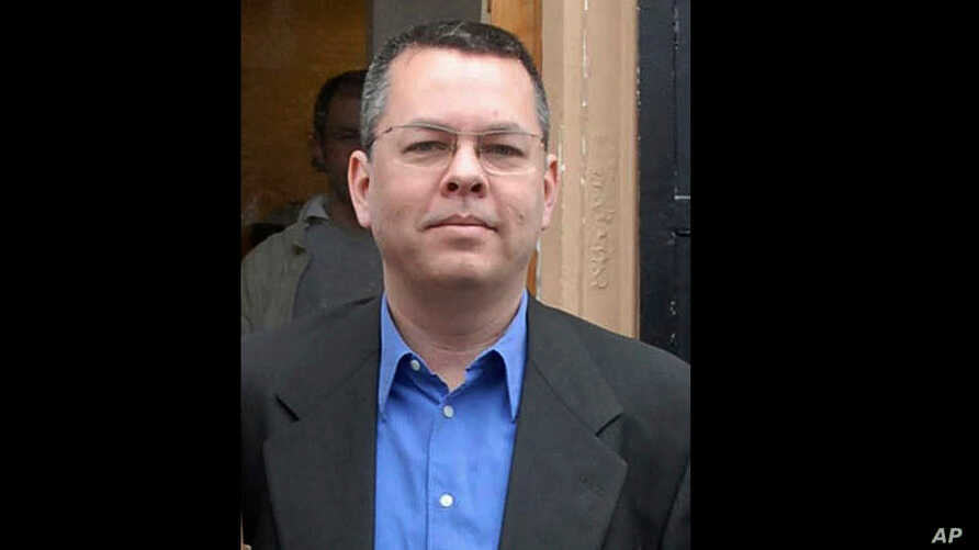 FILE - In this undated file photo, Andrew Brunson, an American pastor, stands in Izmir, Turkey. The trial of an American pastor imprisoned in Turkey, whose case is part of the quagmire of tense relations between Washington and Ankara, is set to begin...