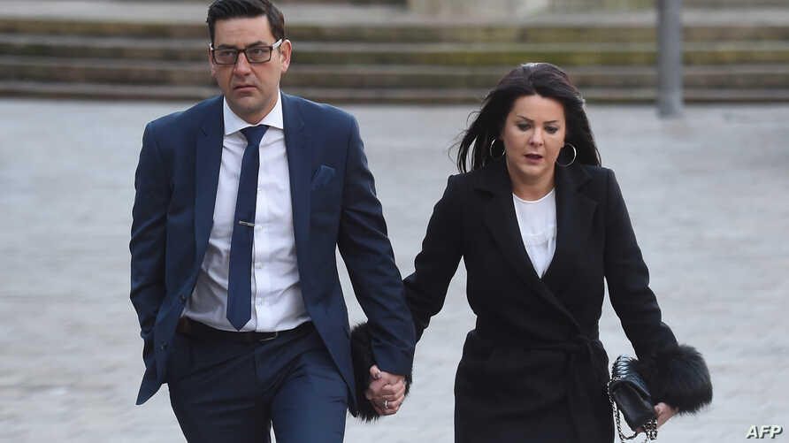 FILE - Former footballer and victim of abuse Andy Woodward (L) arrives at court with his partner Zelda in Liverpool on Jan. 8, 2018 on the first day of the trial of former football coach Barry Bennell.