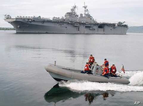 U.S. Navy ship USS Essex, in the back, arrives at the former U.S. naval base in Subic, northern Philippines (2003 file photo)