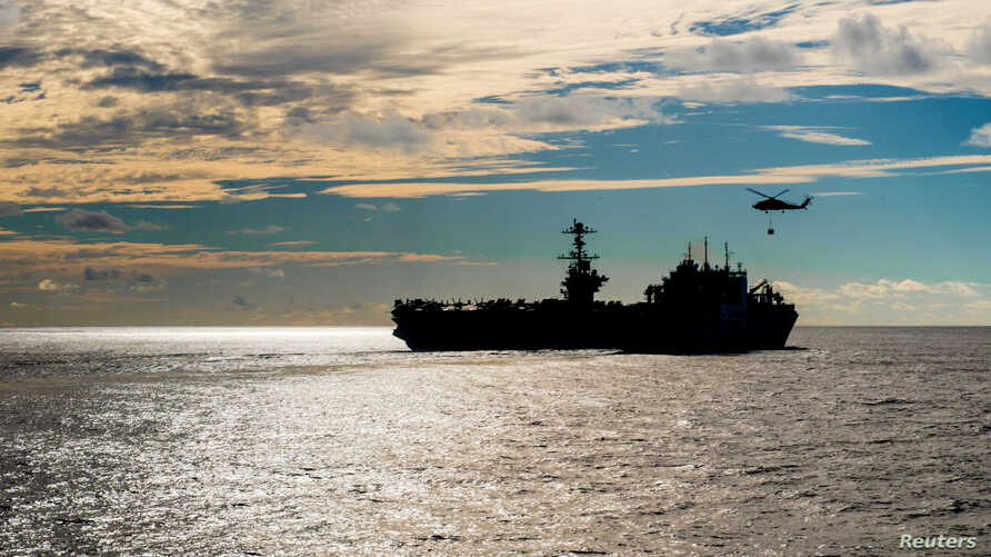 FILE - The Nimitz-class aircraft carrier USS John C. Stennis conducts a replenishment-at-sea with the dry cargo and ammunition ship USNS Charles Drew Nov. 13, 2018.