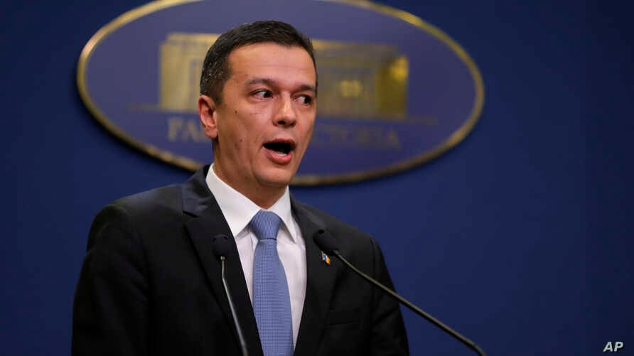 Romania's Prime Minister Sorin Grindeanu addresses reporters during a statement in Bucharest, Feb. 4, 2017. After mass protests that have rocked the country for days, Romania's government says it will repeal an emergency decree that decriminalizes of