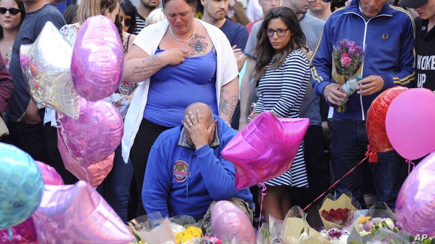 Olivia Campbell's mother, Charlotte Campbell (center) and stepfather, Paul Hodgson (foreground), pay tribute to the victims of the explosion outside Manchester Arena, at St Ann's Square after leading a bikers convoy from their home town of Bury in c
