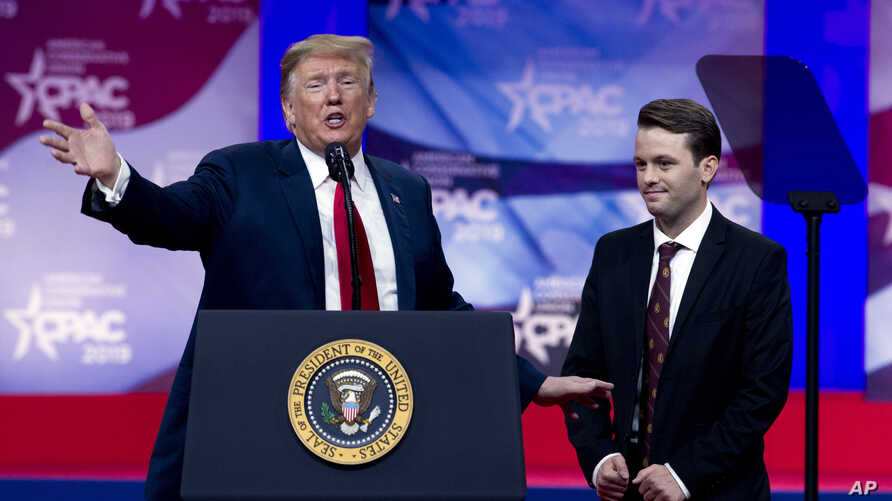 President Donald Trump invites to the podium Hayden Williams, a field representative of the Leadership Institute, who was assaulted at Berkeley campus, at the Conservative Political Action Conference, in Oxon Hill, Md., March 2, 2019.
