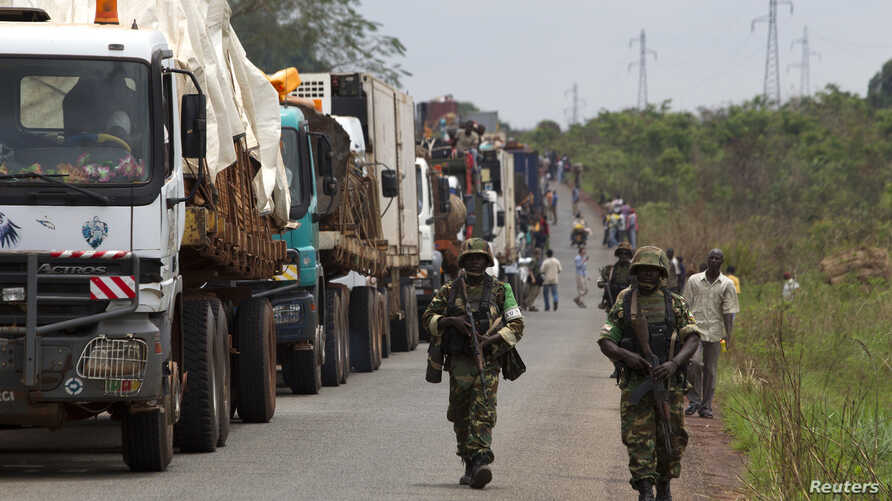 African Union peacekeepers guard a commercial convoy making its way to the border of Cameroon, near Bangui, Central African Republic, March 8, 2014.