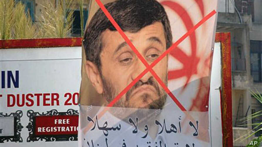 """A poster protesting the upcoming visit to Lebanon by Iranian President Mahmoud Ahmadinejad at a street advertising billboard, with words reading:"""" Rule of the clergy not welcome in Lebanon,"""" Tripoli, 07 Oct 2010"""