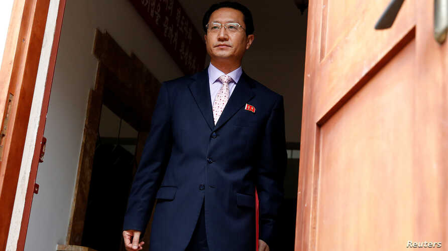 North Korea's ambassador in Peru Kim Hak-Chol walks to meet the media to reads a statement after he was expelled by Peruvian government, in Lima, Peru, Sept. 12, 2017.