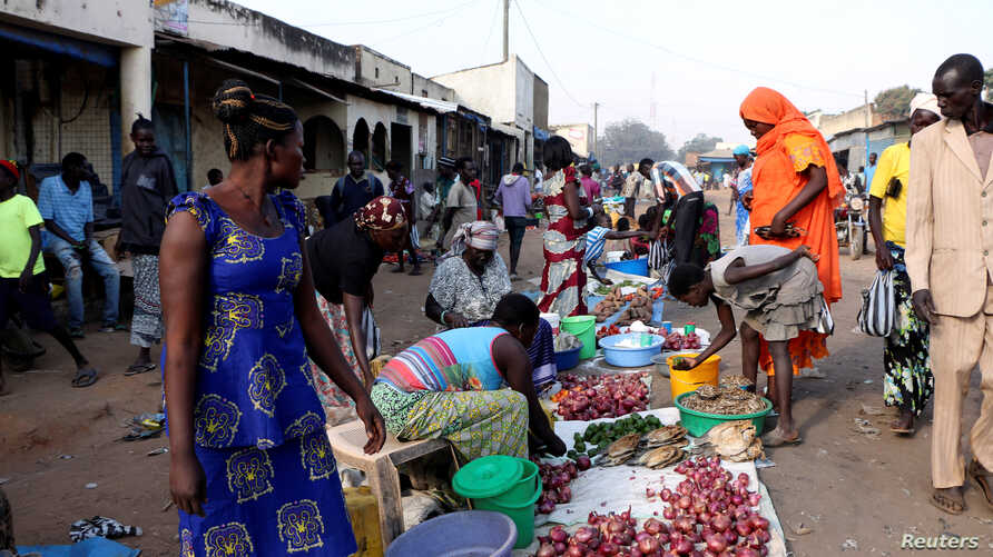 South Sudanese civilians conduct business at the market in Yei, southwest of the capital Juba, Jan. 1, 2017.