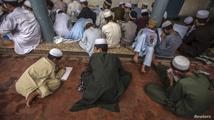 FILE - Pakistani religious students attend a lesson at Darul Uloom Haqqania, an Islamic seminary and alma mater of several Taliban leaders in Akora Khattak, Khyber Pakhtunkhwa province.