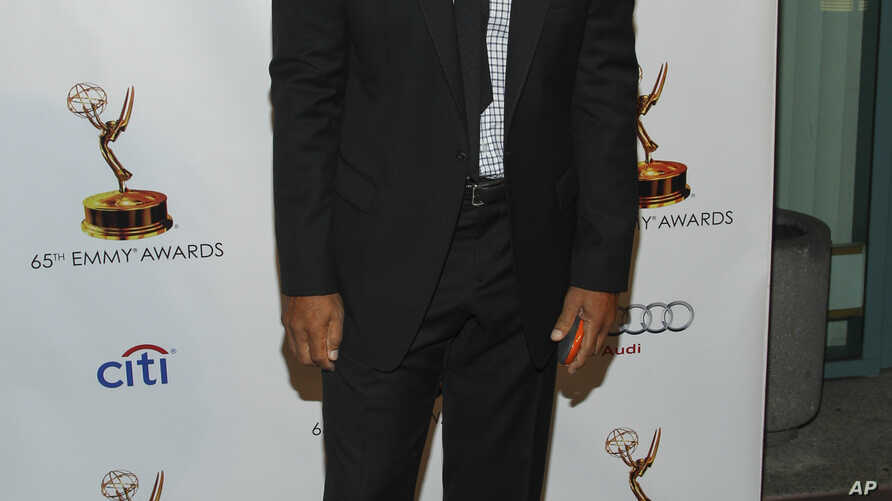 """FILE - Actor Ron Glass arrives at the 65th Emmy Awards Nomination Celebration at the Academy of Television Arts and Sciences in Los Angeles, Sept. 17, 2013. Glass, best known for his role as Ron Harris in """"Barney Miller"""" has died at age 71."""