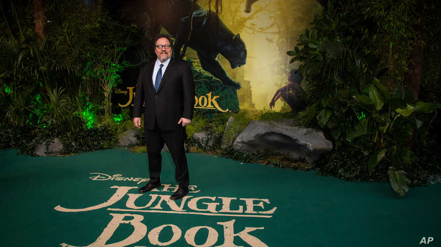 """Director Jon Favreau poses for photographers upon arrival at the European premiere of the film """"The Jungle Book"""" in London, April 13, 2016."""