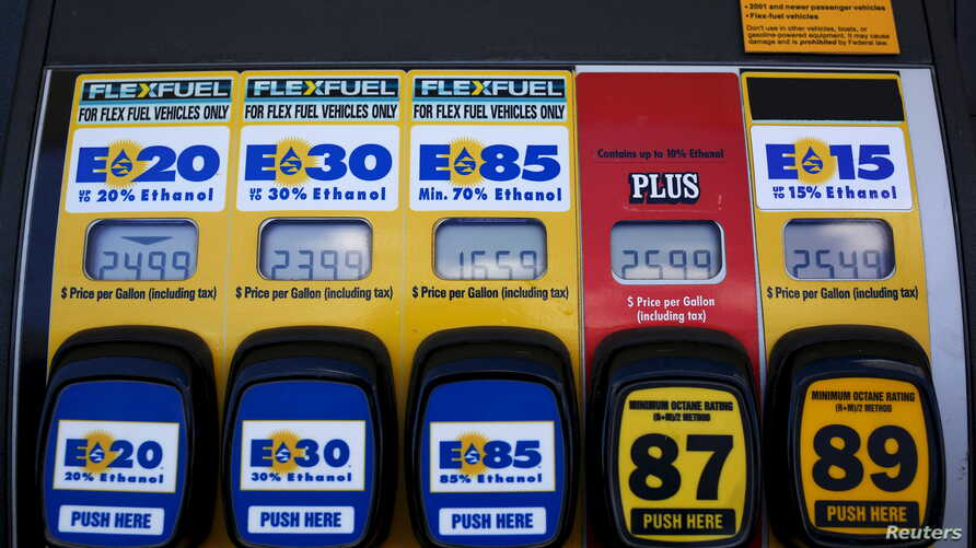 FILE - A gas pump displays the price for E15, a gasoline with 15 percent of ethanol, and various other ethanol blends at a gas station in Nevada, Iowa, May 17, 2015.