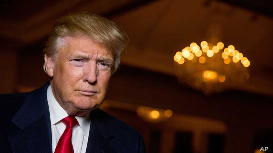 Republican presidential candidate Donald Trump poses for a portrait after an interview with The Associated Press in Sterling, Va., Dec. 2, 2015.