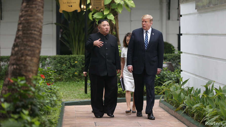 North Korea's leader Kim Jong Un and U.S. President Donald Trump talk in the garden of the Metropole hotel during the second North Korea-U.S. summit in Hanoi, Vietnam Feb. 28, 2019.