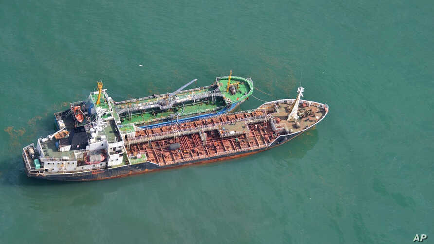 FILE - This May 24, 2018, photo released by Japan's Ministry of Defense shows North Korean-flagged tanker SAM JONG 2, bottom, alongside MYONG RYU 1, a vessel of unknown nationality, in the East China Sea. Japan's Foreign Ministry said a Japanese navy