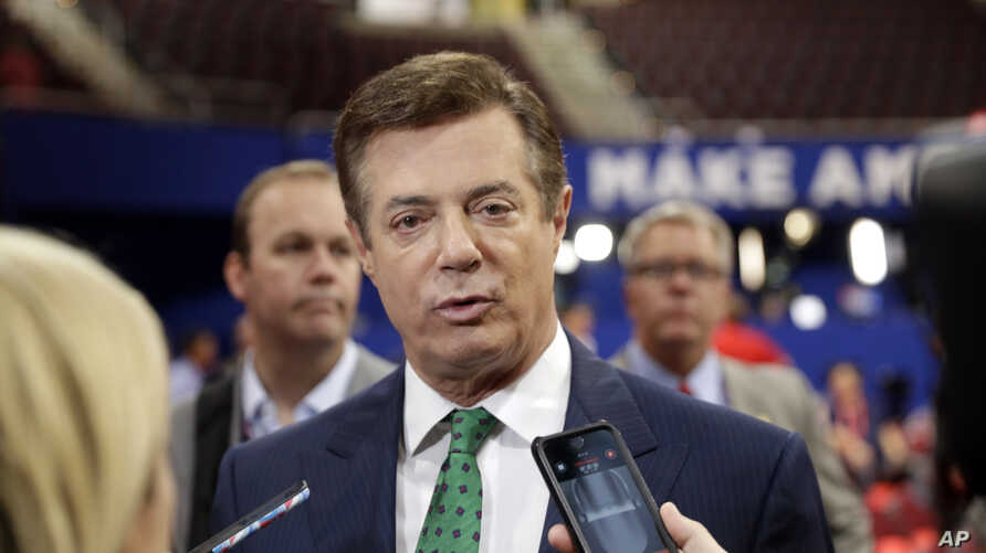 Trump Campaign Chairman Paul Manafort talks to reporters on the floor of the Republican National Convention at Quicken Loans Arena, July 17, 2016, in Cleveland.