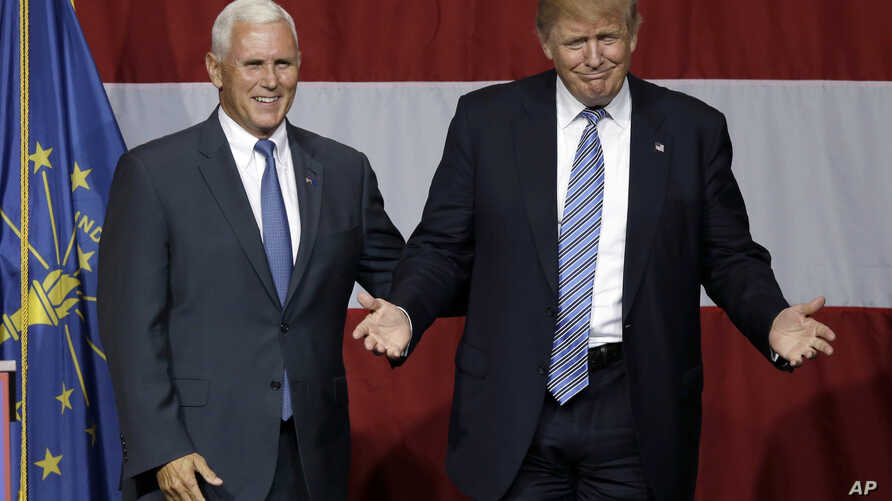 Indiana Gov. Mike Pence joins Republican presidential candidate Donald Trump at a rally in Westfield, Ind., July 12, 2016. U.S. media reports say Trump will announce on Friday that Pence is his running mate.