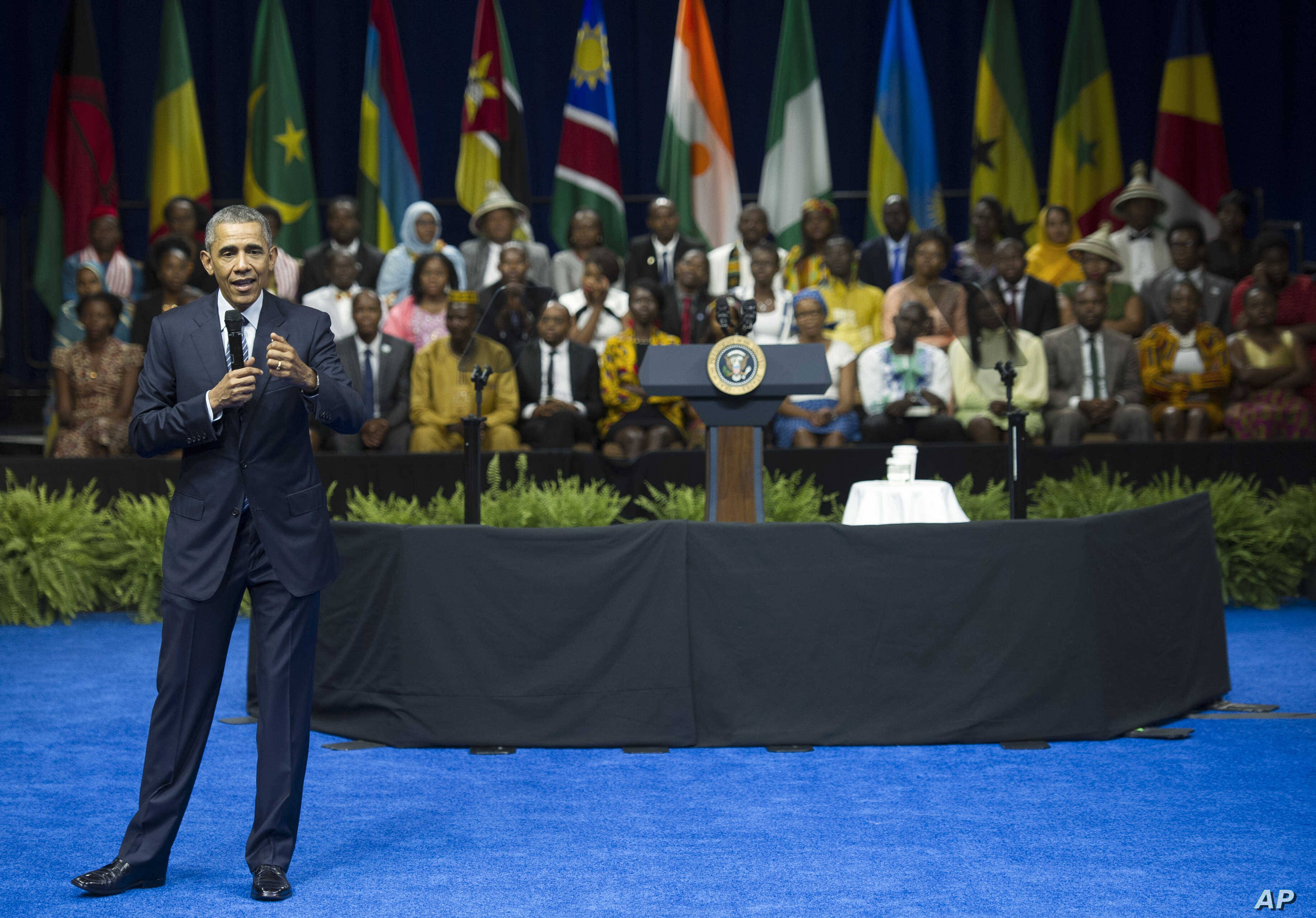 FILE - President Barack Obama answers questions from participants after speaking at the Young African Leaders Initiative's Mandela Washington Fellowship gathering in Washington, Aug. 3, 2015.
