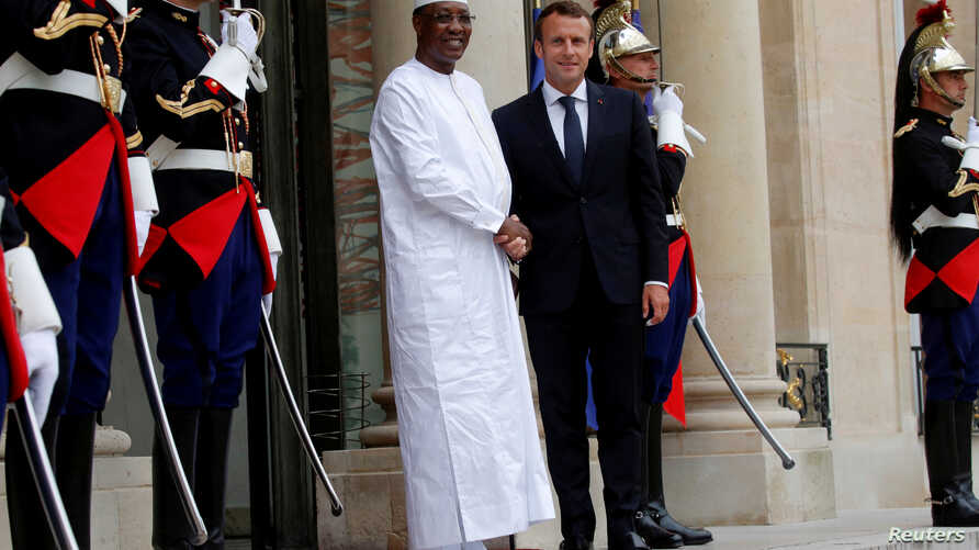 FILE - French President Emmanuel Macron welcomes Chad's President Idriss Deby Itno as he arrives to attend an international conference on Libya at the Elysee Palace in Paris, May 29, 2018.
