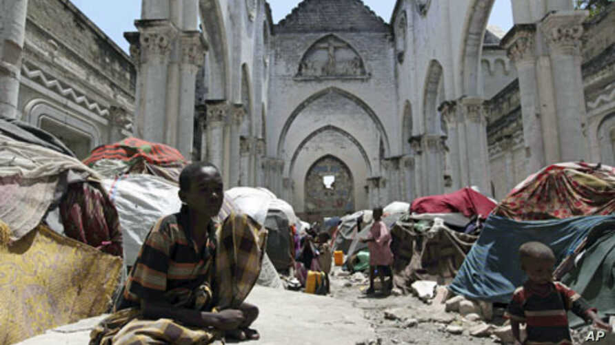 Internally displaced Somali families settle inside a war-devastated cathedral building in the old center of Mogadishu, Somalia, August 2011. (file photo)