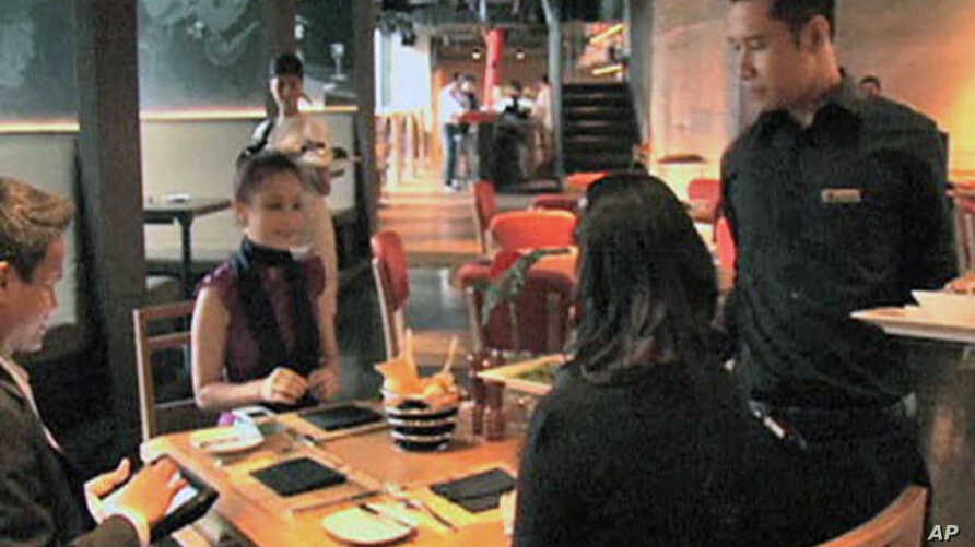 Diners enjoy a meal at the newly-opened Smoking Joe's Barbecue and Lounge, which serves genuine American barbecue, in Jakarta, Indonesia, May 2011