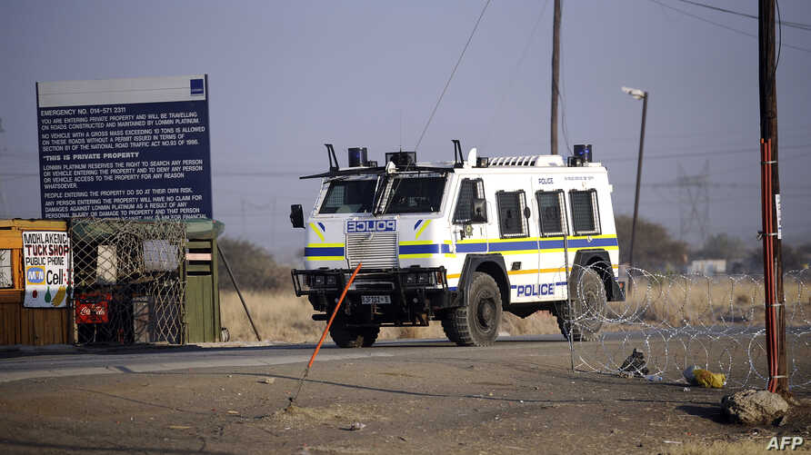 A police vehicle is parked outside the Marikana platinum mine, where police opened fire on hundreds of workers staging a wildcat strike on August 16 that has left 44 dead, August 21, 2012.