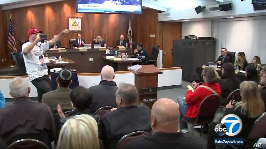 In this March 19, 2018 image made from video provided by KABC-7, council members listen during a meeting in Los Alamitos, California. Leaders of the small California city of 12,000 people voted this week to exempt it from California's sanctuary law.