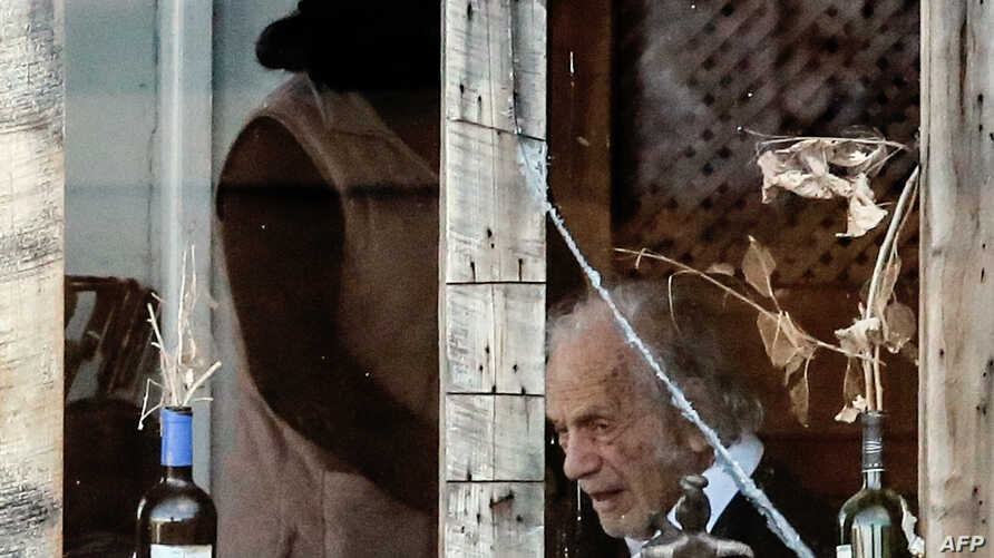 FILE - Chilean poet Nicanor Parra is seen inside his home in Las Cruces, some 100 km west of Santiago, during his 100th birthday, on Sept. 5, 2014.