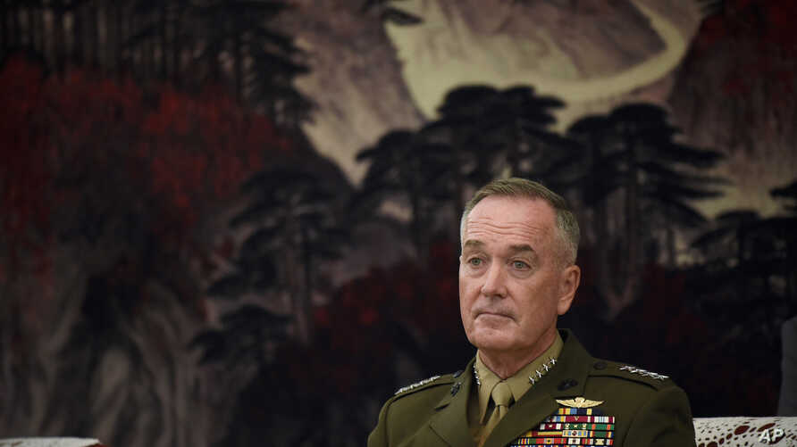 U.S. Joint Chiefs of Staff, Marine Corps Gen. Joseph Dunford listens to Chinese Vice Chairman of the Central Military Commission Fan Changlong during a meeting in Beijing, Aug. 17, 2017.