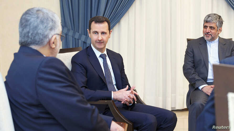 Syria's President Bashar al-Assad (C) meets Alaeddin Boroujerdi (L), head of the Iranian parliamentary committee for national security and foreign policy, in Damascus September 1, 2013 in this handout released by Syria's national news agency SANA. As