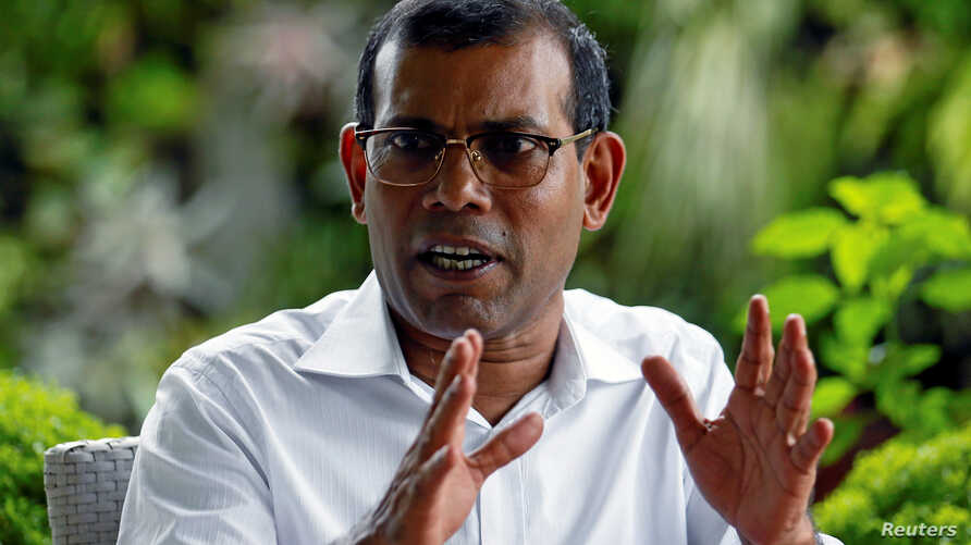 FILE - Former Maldives President Mohamed Nasheed speaks during an interview in Colombo, Sri Lanka, June 4, 2018. He said June 29 that he would step aside as MDP presidential candidate after the national electioncommission ruled him ineligible to run