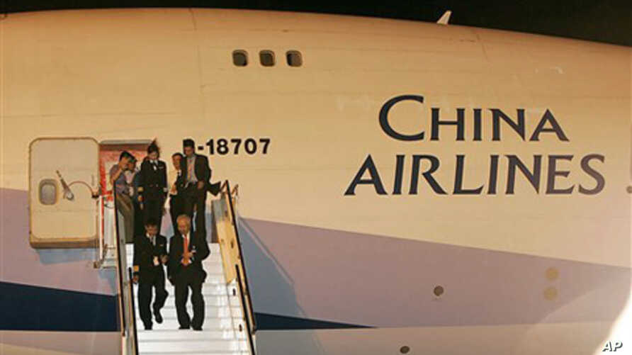 Taiwanese pilots and crews are escorted by Chinese officials from a Taiwanese carrier at Pudong international airport in Shanghai, China (FILE).