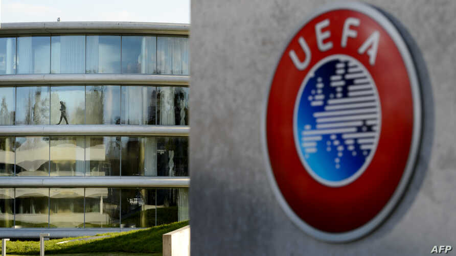 A man walks inside the headquarters of European football body UEFA in Nyon on April 6, 2016. Swiss police raided the UEFA headquarters on April 6 following the latest revelations of a web of Panama-based offshore financial dealings by the rich and fa