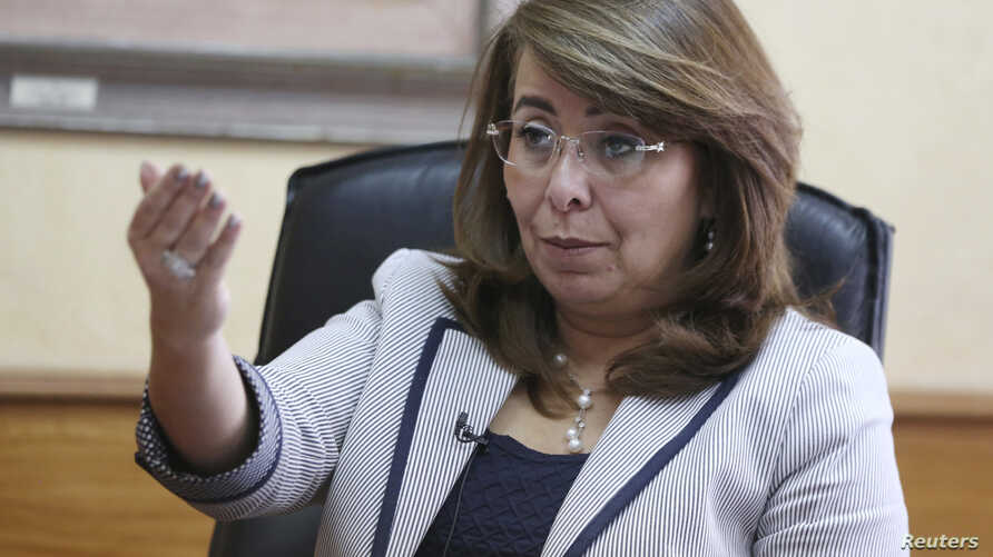 FILE - Egyptian Minister of Social Solidarity Ghada Wali talks during an interview at her office in Cairo, Oct. 20, 2014.
