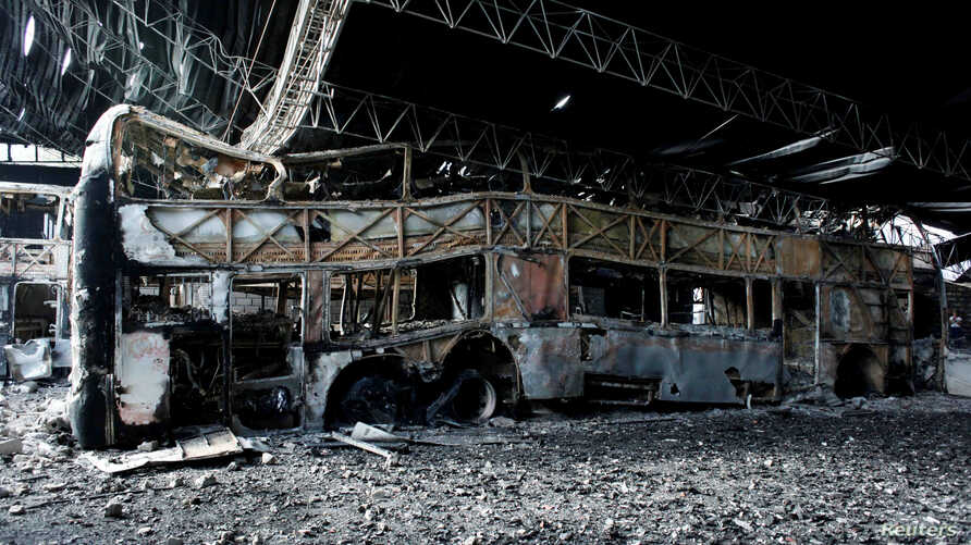 Destroyed buses are seen after a fire in a parking lot in San Cristobal, Venezuela May 17, 2017.