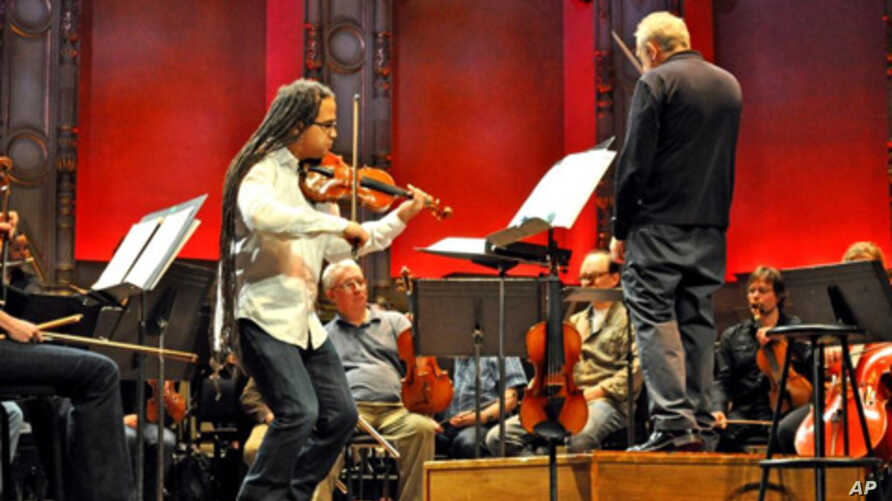 Haitian-American violinist Daniel Bernard Roumain rehearsing with Maestro Bramwell Tovey and the Vancouver Symphony Orchestra on February 14, 2010.