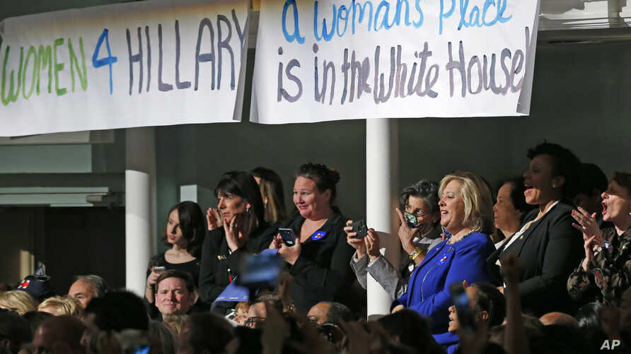 Women attending a Women for Hillary event react as Democratic presidential candidate Hillary Clinton speaks at at the New York Hilton hotel in midtown Manhattan one day ahead of the New York primary, April 18, 2016.
