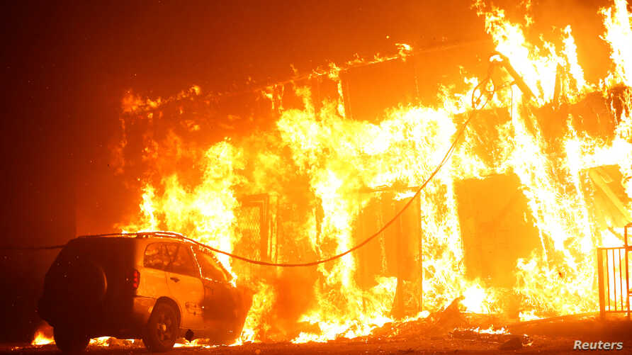 A structure is seen engulfed in flames during the Camp Fire in Paradise, California, U.S., Nov. 8, 2018.