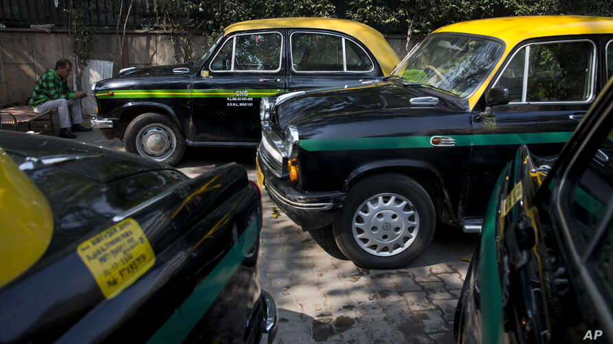 Hindustan Ambassadors taxis are parked outside a hotel in New Delhi, India, Feb. 13, 2017.