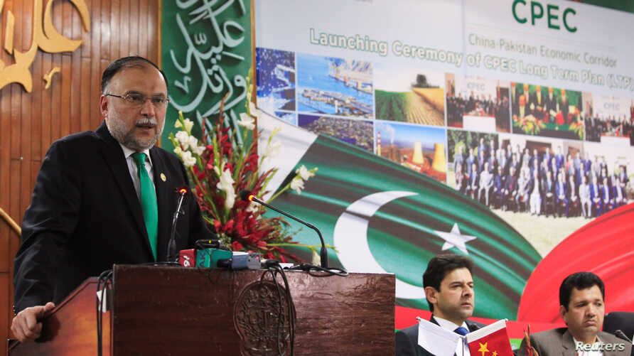 FILE - Ahsan Iqbal, then Pakistan's minister for planning and development, speaks during the launch ceremony of the China-Pakistan Economic Corridor (CPEC) long-term cooperation plan, in Islamabad, Pakistan, Dec. 18, 2017.