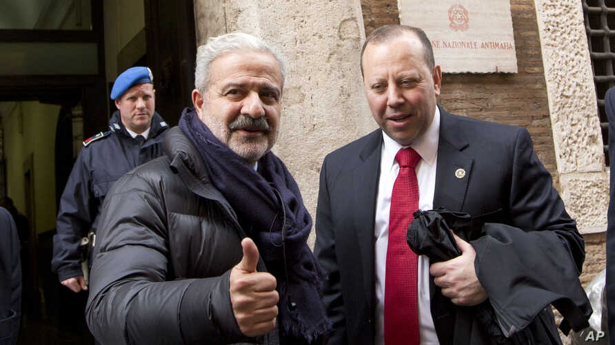 FILE - Reggio Calabria head of Police Guido Longo (L) gives the thumbs up next to FBI special agent Leo Taddeo following a joint Italian-U.S. authorities' press conference on an anti-Mafia blitz with numerous arrests reported on both sides of the Atl