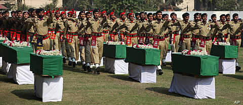 Pakistan army soldiers attend funeral ceremony of Saturday's NATO attack victims in Peshawar, Pakistan, November  27, 2011.