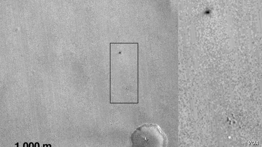 What is believed to be the crash site of the Schiaparelli probe in this picture taken by NASA's Mars Reconnaissance Orbiter.