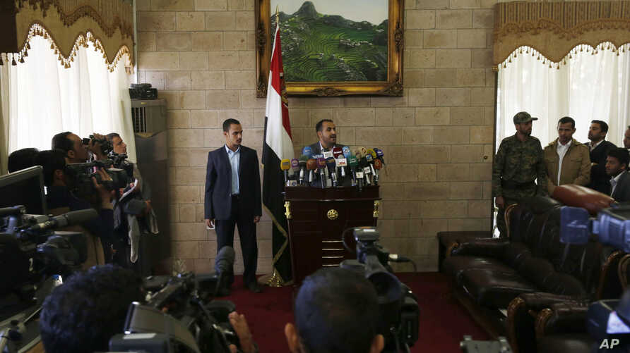 The spokesman of the Shi'ite rebels known as Houthis, Mohammed Abdel Salam, center, speaks at a press conference prior to the departure of the Houthi delegation for the Geneva peace talks, in Sana'a, Yemen, Dec. 12, 2015.