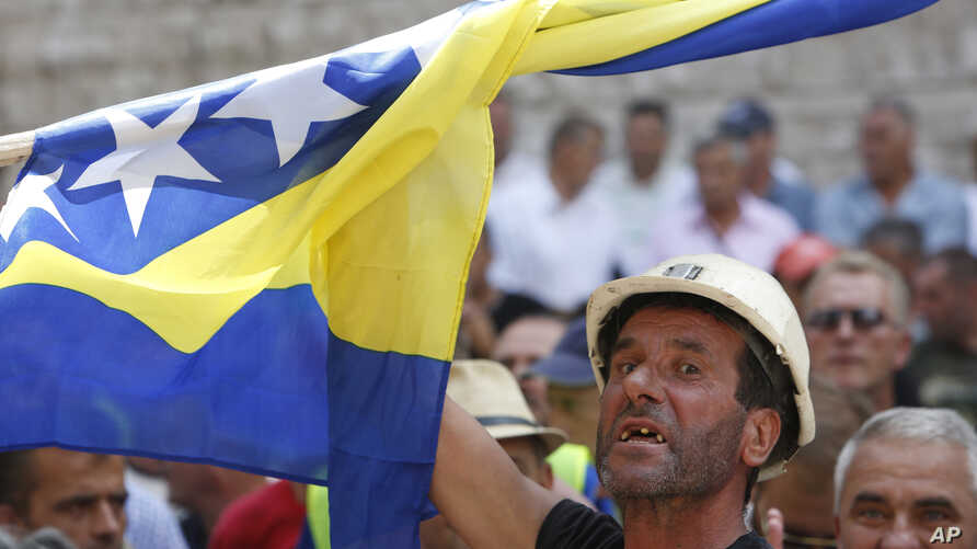 Bosnian worker chants slogans during protest in Bosnian capital of Sarajevo, July 30, 2015.