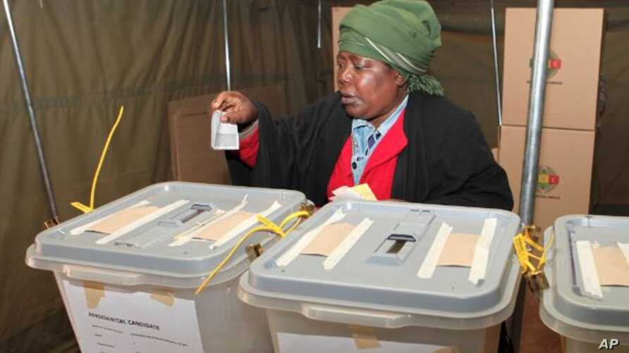 FILE: A woman casts her vote in presidential and parliamentary elections in Zimbabwe's capital, Harare, July, 31, 2013. Four women are among the presidential candidates seeking election on Monday.