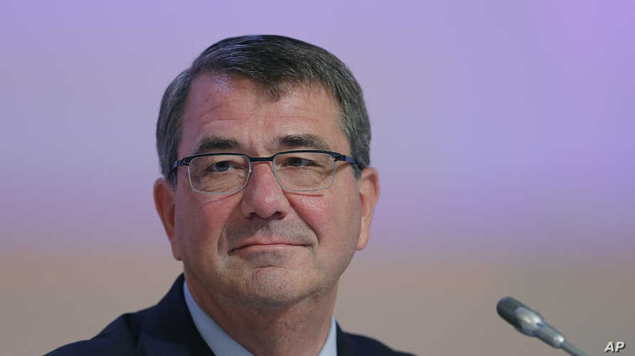 FILE - U.S. Secretary of Defense Ashton Carter delivers a speech during the 14th International Institute for Strategic Studies Shangri-la Dialogue, or IISS, Asia Security Summit, May 30, 2015, in Singapore.