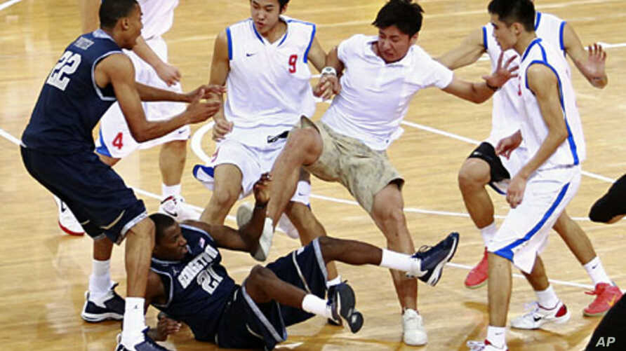 Players from American Georgetown University men's basketball team and China's Bayi men's basketball team fight during a friendly game at the Beijing Olympic Basketball Arena August 18, 2011