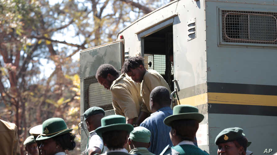 Suspected demonstrators make a court appearance in Harare, Zimbabwe, Aug. 29, 2016.